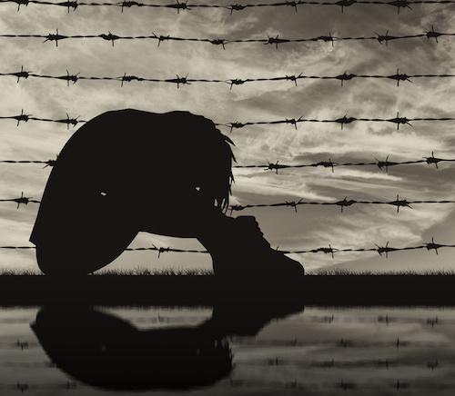 Concept of refugee. Silhouette Despair refugee woman near the fence of barbed wire and reflection
